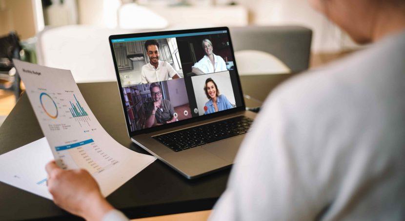 ennVee webinar hero – computer with video call in progress, smiling people on screen for webinar